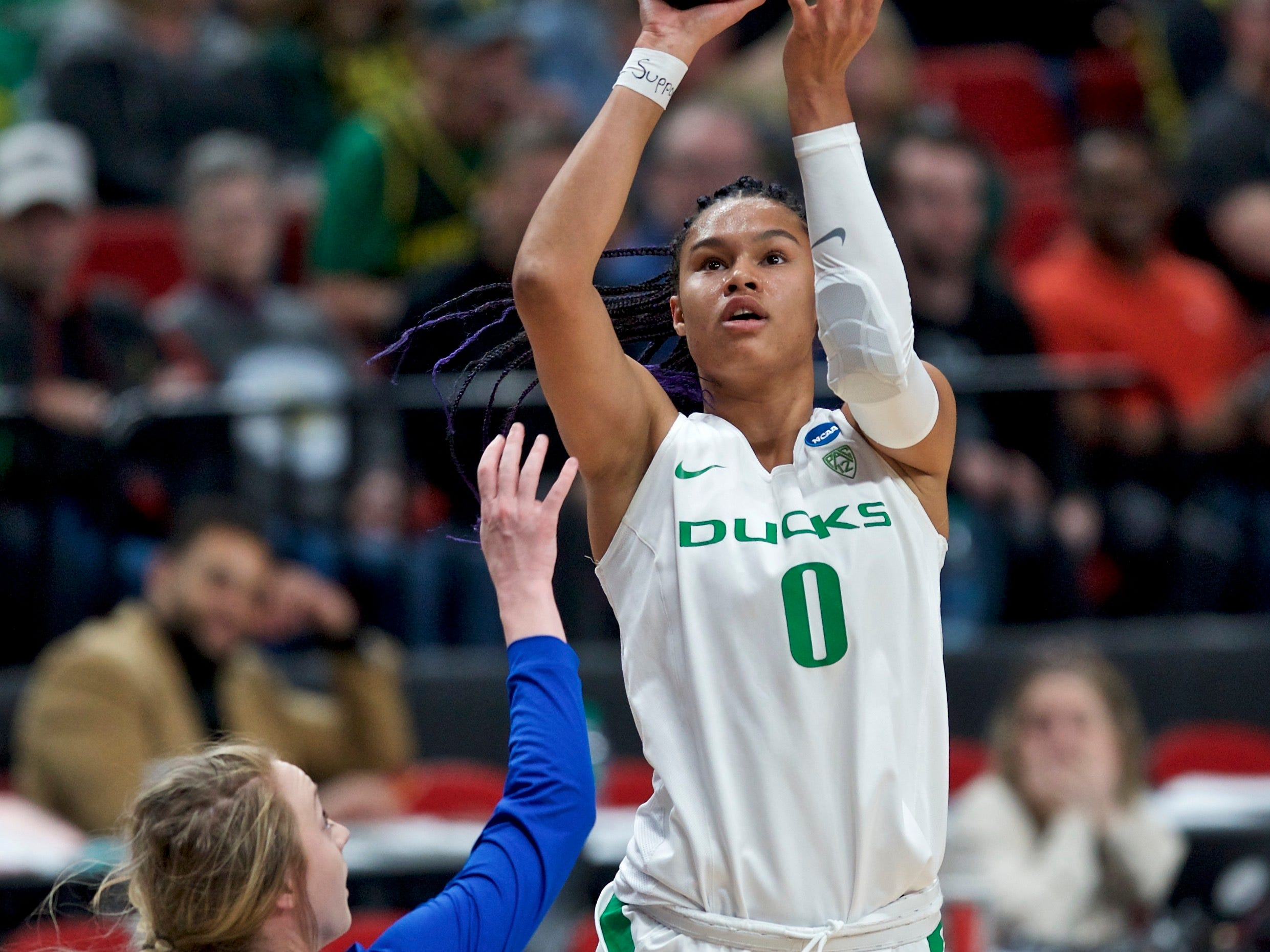 Oregon forward Satou Sabally, right, shoots over South Dakota State guard Madison Guebert during the first half of a regional semifinal in the NCAA women's college basketball tournament Friday, March 29, 2019, in Portland, Ore. (AP Photo/Craig Mitchelldyer)