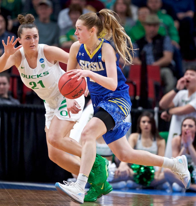 South Dakota State guard Tylee Irwin is defended by Oregon forward Erin Boley during the first half of a regional semifinal in the NCAA women's college basketball tournament Friday, March 29, 2019, in Portland, Ore. (AP Photo/Craig Mitchelldyer)