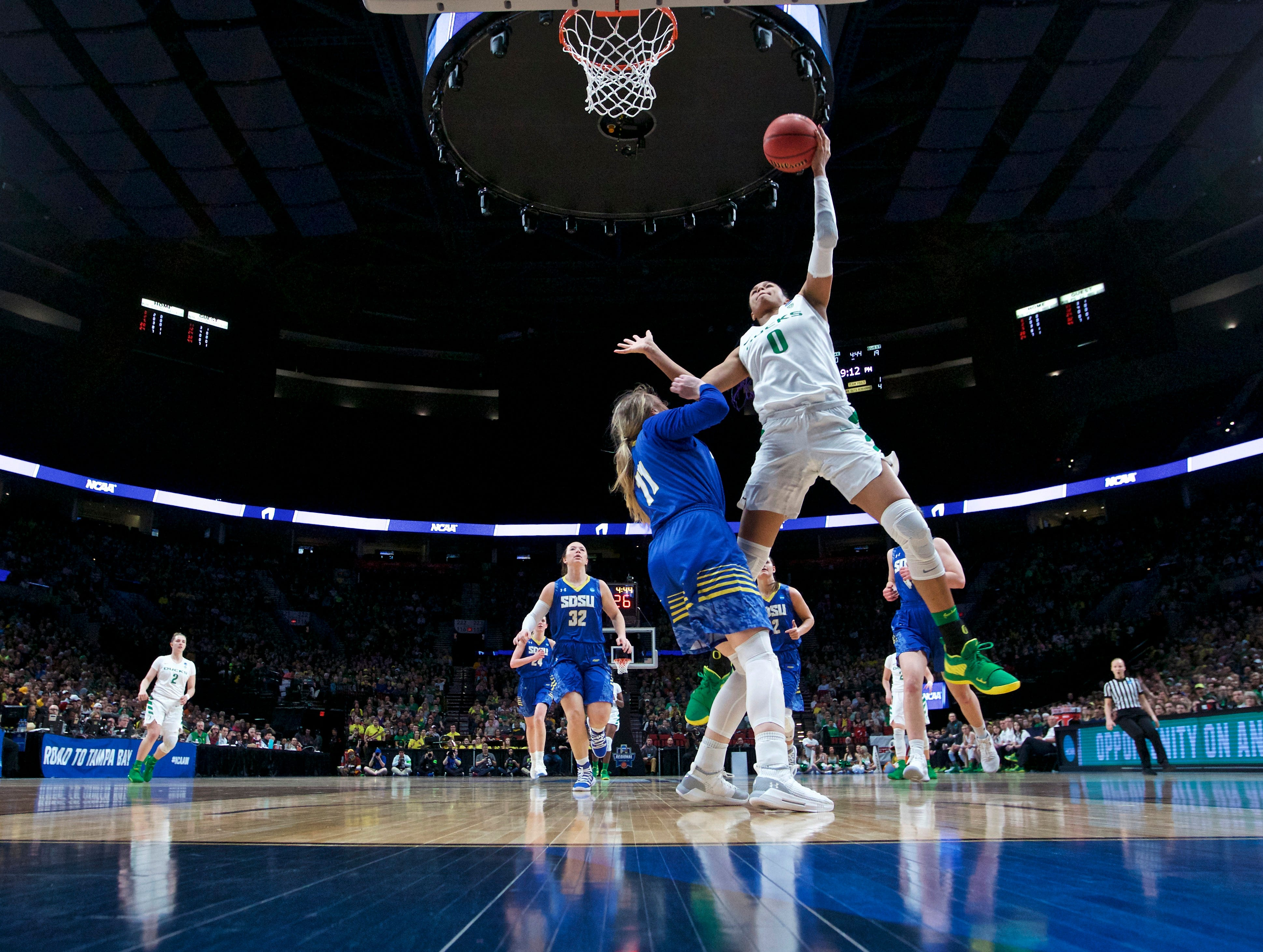 Oregon forward Satou Sabally, right, shoots over South Dakota State guard Madison Guebert during the second half of a regional semifinal in the NCAA women's college basketball tournament Friday, March 29, 2019, in Portland, Ore. Oregon won 63-53. (AP Photo/Craig Mitchelldyer)