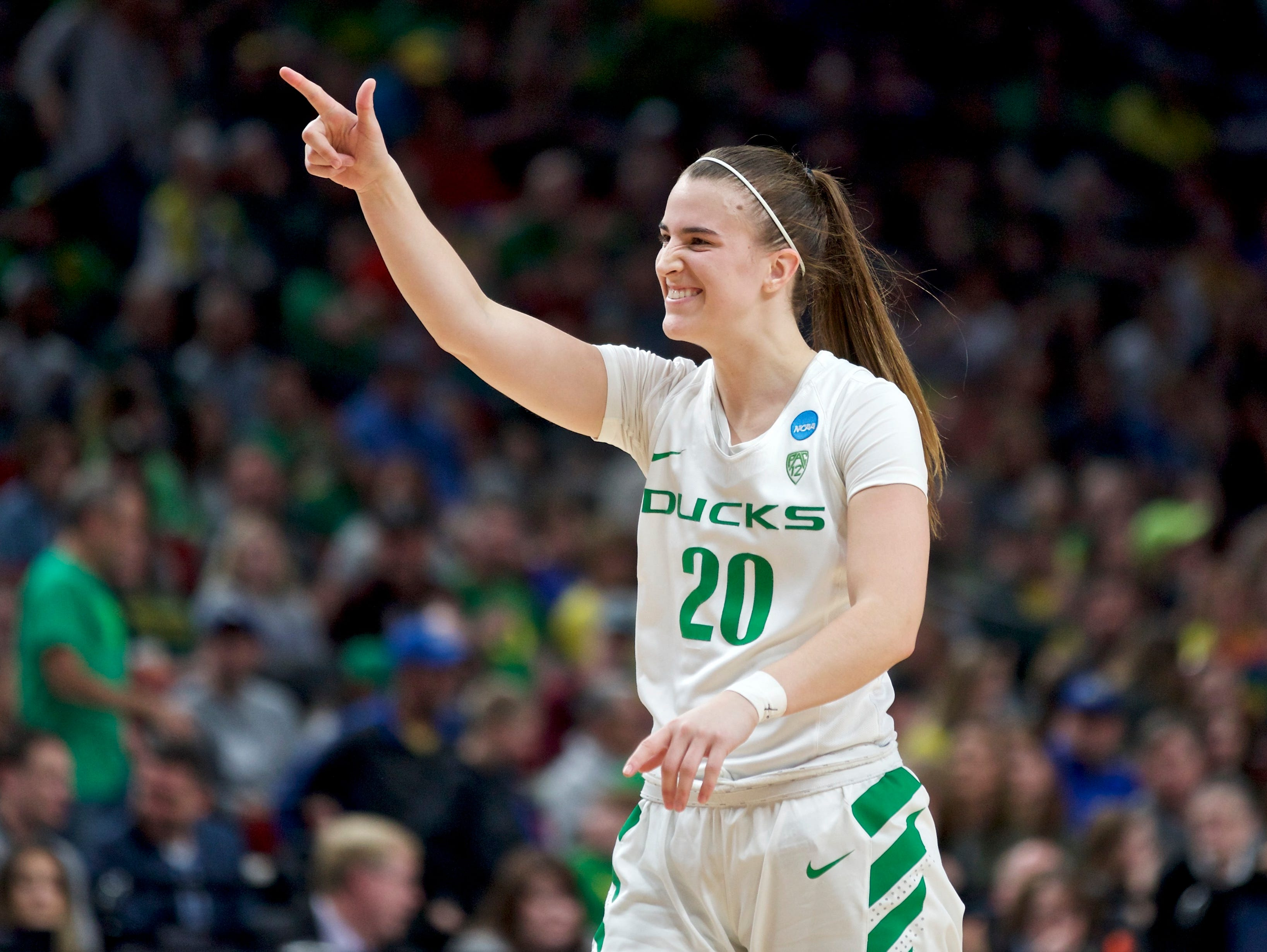Oregon guard Sabrina Ionescu gestures toward the bench during the second half of the team's regional semifinal against South Dakota State in the NCAA women's college basketball tournament Friday, March 29, 2019, in Portland, Ore. Oregon won 63-53. (AP Photo/Craig Mitchelldyer)
