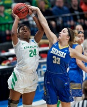 Oregon forward Ruthy Hebard, left, shoots over South Dakota State forward Paiton Burckhard during the first half of a regional semifinal in the NCAA women's college basketball tournament Friday, March 29, 2019, in Portland, Ore. (AP Photo/Craig Mitchelldyer)
