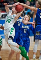 Oregon guard Sabrina Ionescu, left, has a shot blocked by South Dakota State guard Tylee Irwin during the first half of a regional semifinal in the NCAA women's college basketball tournament Friday, March 29, 2019, in Portland, Ore. (AP Photo/Craig Mitchelldyer)