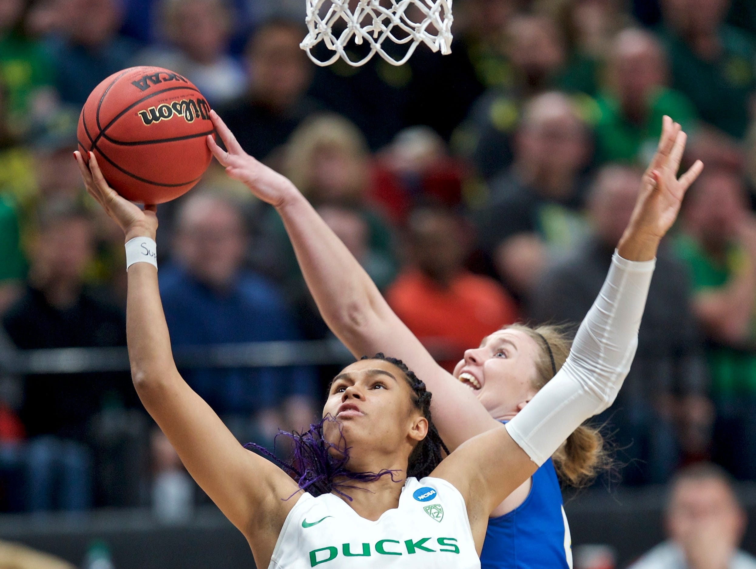 Oregon forward Satou Sabally, left, has a shot blocked by South Dakota State forward Myah Selland during the first half of a regional semifinal in the NCAA women's college basketball tournament Friday, March 29, 2019, in Portland, Ore. (AP Photo/Craig Mitchelldyer)