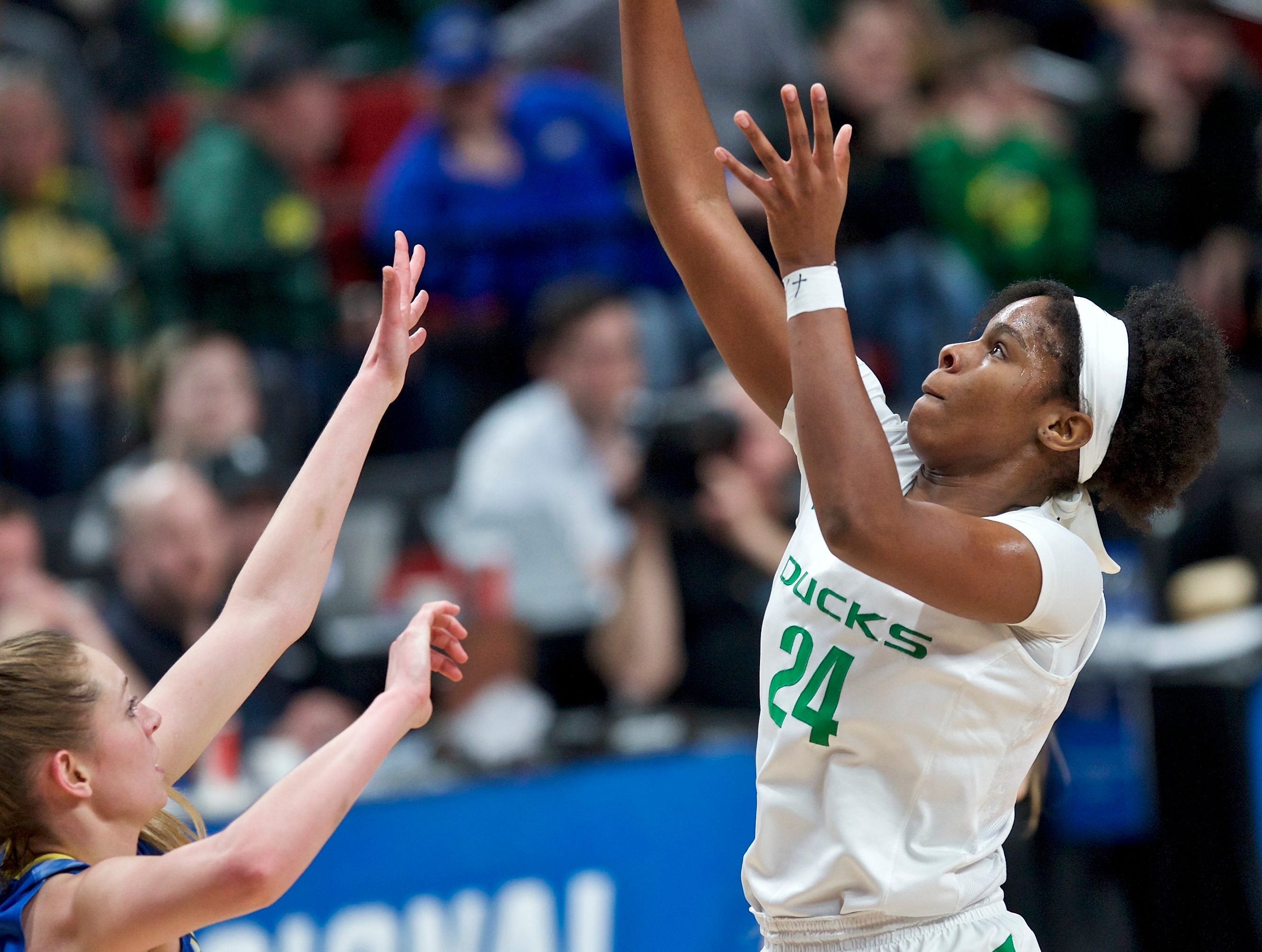 Oregon forward Ruthy Hebard, right, shoots over South Dakota State forward Tagyn Larson during the first half of a regional semifinal in the NCAA women's college basketball tournament Friday, March 29, 2019, in Portland, Ore. (AP Photo/Craig Mitchelldyer)