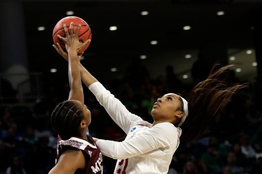 Missouri State's Brice Calip blocks a shot by Stanford's DiJonai Carrington (21) during the first half of a regional semifinal game in the NCAA women's college basketball tournament, Saturday, March 30, 2019, in Chicago.