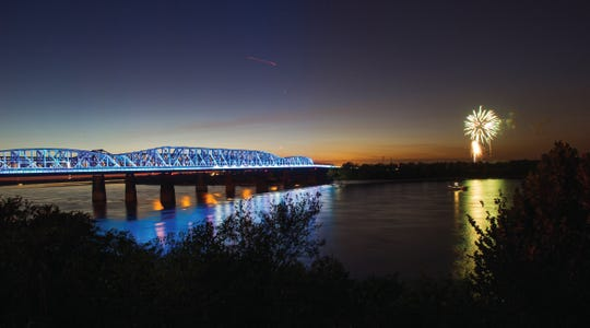 The bridge lights up at night and changes colors.