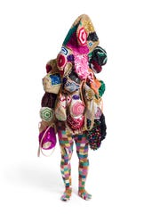 NICK CAVE, Soundsuit, 2009, Mixed media including sisal, knitted fabric, metal armature, plastic, electrical tape, 103 x 38 x 26 inches © Nick Cave.
