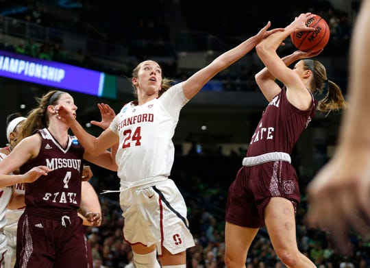 Missouri State Lady Bear Danielle Gitzen shoots a field goal as Stanford's Lacie Hull gets her hand on Gitzen to deflect the shot during the NCAA Division I Women's Regional at Wintrust Arena in Chicago, Ill. on Saturday, March 30, 2019.