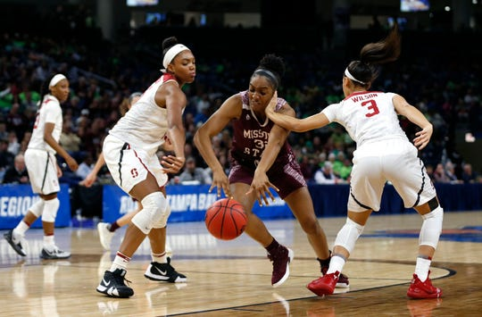 Missouri State Lady Bear Jasmine Franklin drives through Stanford Cardinal Anna Wilson and Maya Dodson during the NCAA Division I Women's Regional at Wintrust Arena in Chicago, Ill. on Saturday, March 30, 2019.