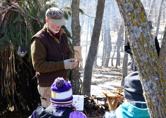 Volunteer and former science teacher Mike Leedahl explains how Native Americans would convert sap into maple syrup Saturday, March 30 in Collegeville. Leedahl has been volunteering with the Maple Syrup Festival for 10 years.