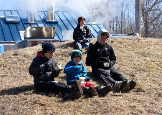 From left: Olson family siblings Anika, 14, Nathan, 8, Philip, 12, and Anthony, 16, enjoy maple syrup sundaes and hot chocolate at the Maple Syrup Festival Saturday, March 30 in Collegeville. The family came from Chaska to enjoy the fest.