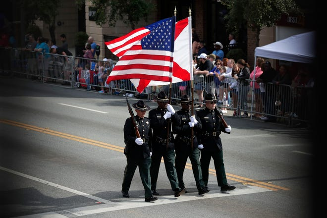 Groups and organizations take to Monroe St. as fans cheer them on during the Springtime Tallahassee Grand Parade Saturday, March 30, 2019.