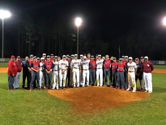 Wakulla Christian's baseball team and Wakulla FCA raised the money for Chase Crum, whose parents Corey and Shana Crum were killed in a tragic accident, to go to college. Chase Crum was Liberty County's baseball coach and a former resident of Wakulla. The scholarship was awarded to Chase Crum during the Saints' and Bulldogs' game this past week.