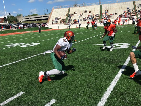 FAMU wide receiver Derrick Hall makes a catch near the sideline in the FAMU Orange & Green Game on Saturday, March 30 at Bragg Memorial Stadium.