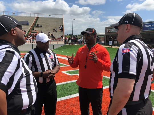 FAMU football head coach Willie Simmons discusses the set up for the Orange & Green Game with the officials on Saturday, March 30, 2019 at Bragg Memorial Stadium.
