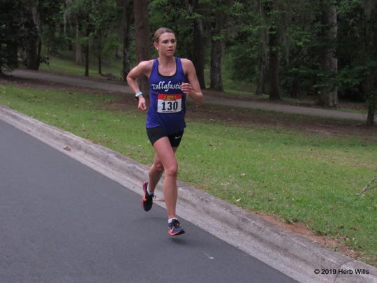 Ann Centner, on Myers Park Drive and less than one-half mile from the finish line, was the top women's finisher in Saturday's Springtime Tallahassee 10K.