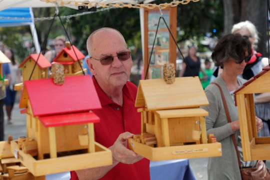 Mark Edwards looks at birdhouses at Jubilee in the Park Saturday, March 30, 2019.