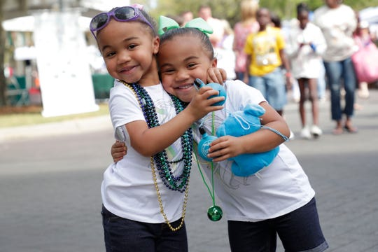 Leah Joseph, left, and her twin sister Eva Joseph, 3, pose for a photo at Jubilee in the Park Saturday, March 30, 2019.