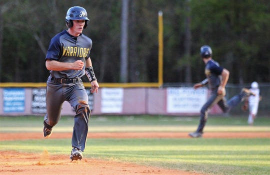 Aucilla Christian's Brandon Hannon races to third base as Wakulla Christian beat Aucilla Christian 6-2 on Friday, March 29, 2019.