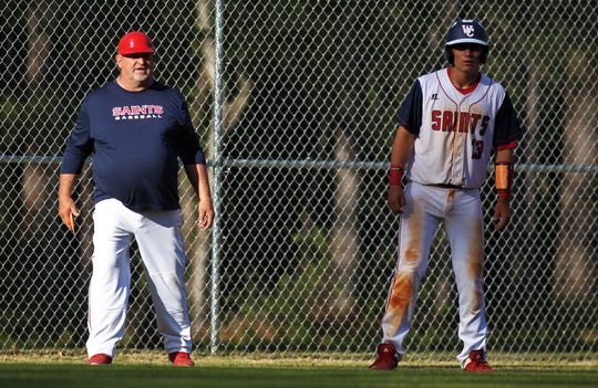 Wakulla Christian baseball coach Bubba Dempsey gives instructions as Lyric Oaks gets a lead off third as the host Saints beat Aucilla Christian 6-2 on Friday, March 29, 2019.
