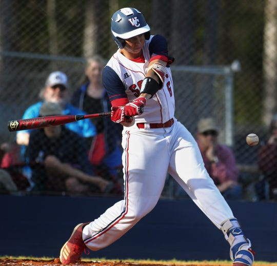 Wakulla Christian junior Seth Dudley swings at a pitch as the host Saints beat Aucilla Christian 6-2 on Friday, March 29, 2019.