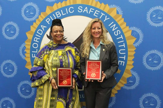 Leon County Circuit Court Judge Kathy Garner, left, and Special Agent Bruce Smith, Division of Alcoholic Beverages and Tobacco, were honored at FPSI's Women's History Month Breakfast.