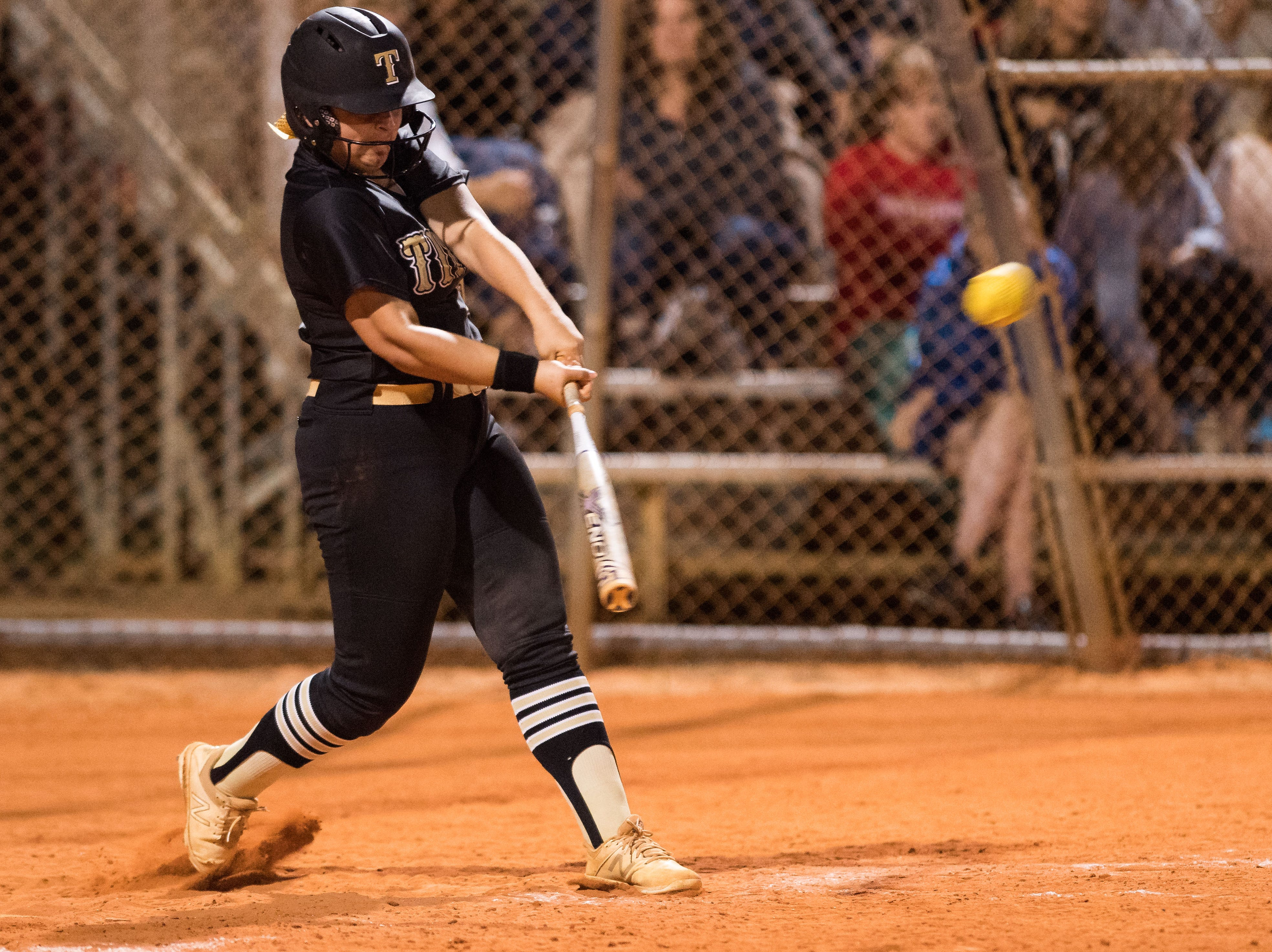 Treasure Coast's 6 hits a double, inches away from a home run, against Vero Beach during the sixth inning of the high school softball game Friday, March 29, 2019, at Vero Beach High School.