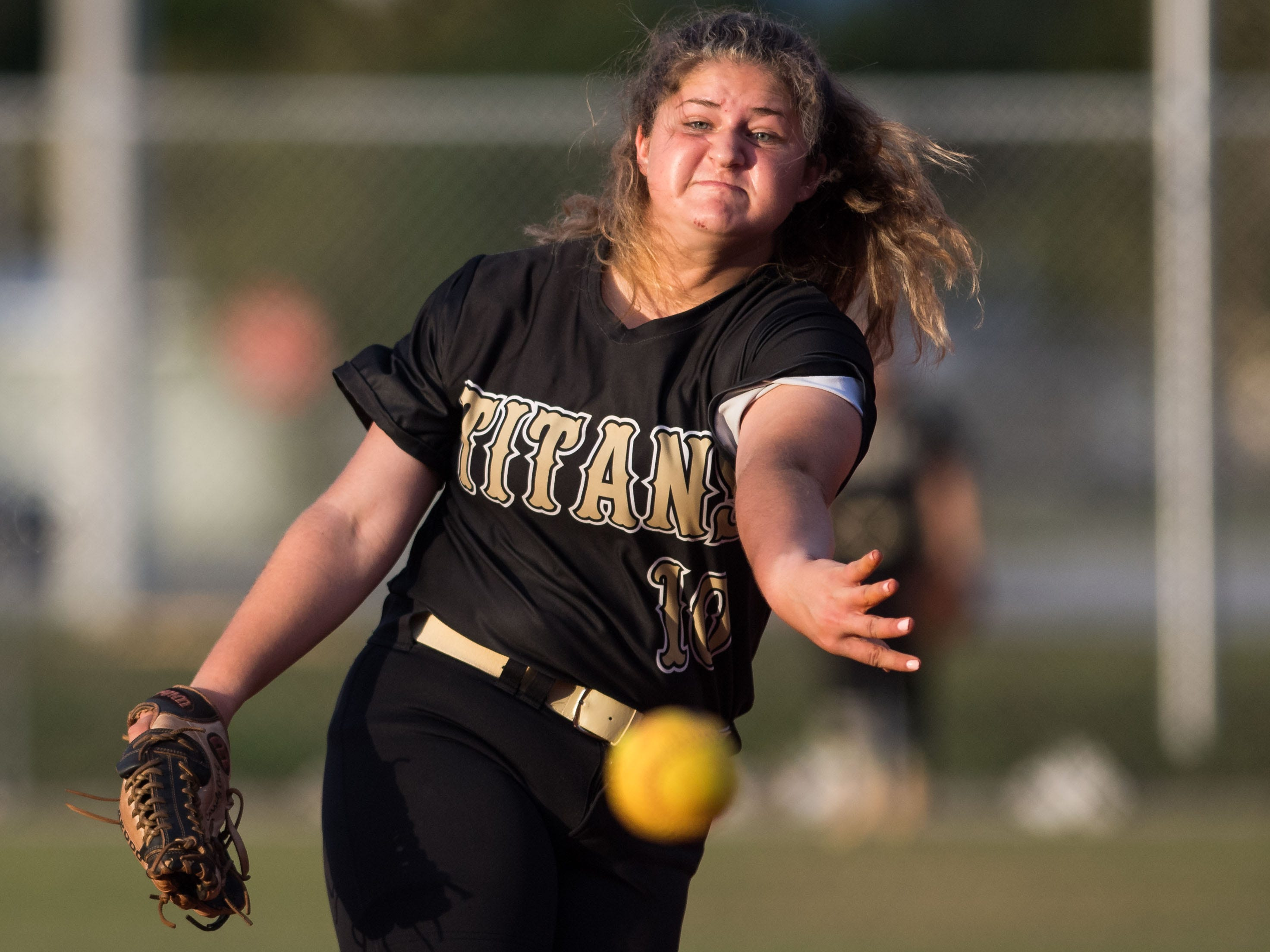 Treasure Coast pitcher Cassidy Curd throws against Vero Beach's Shayne Hewitt in the bottom of the first inning of the high school softball game Friday, March 29, 2019, at Vero Beach High School.