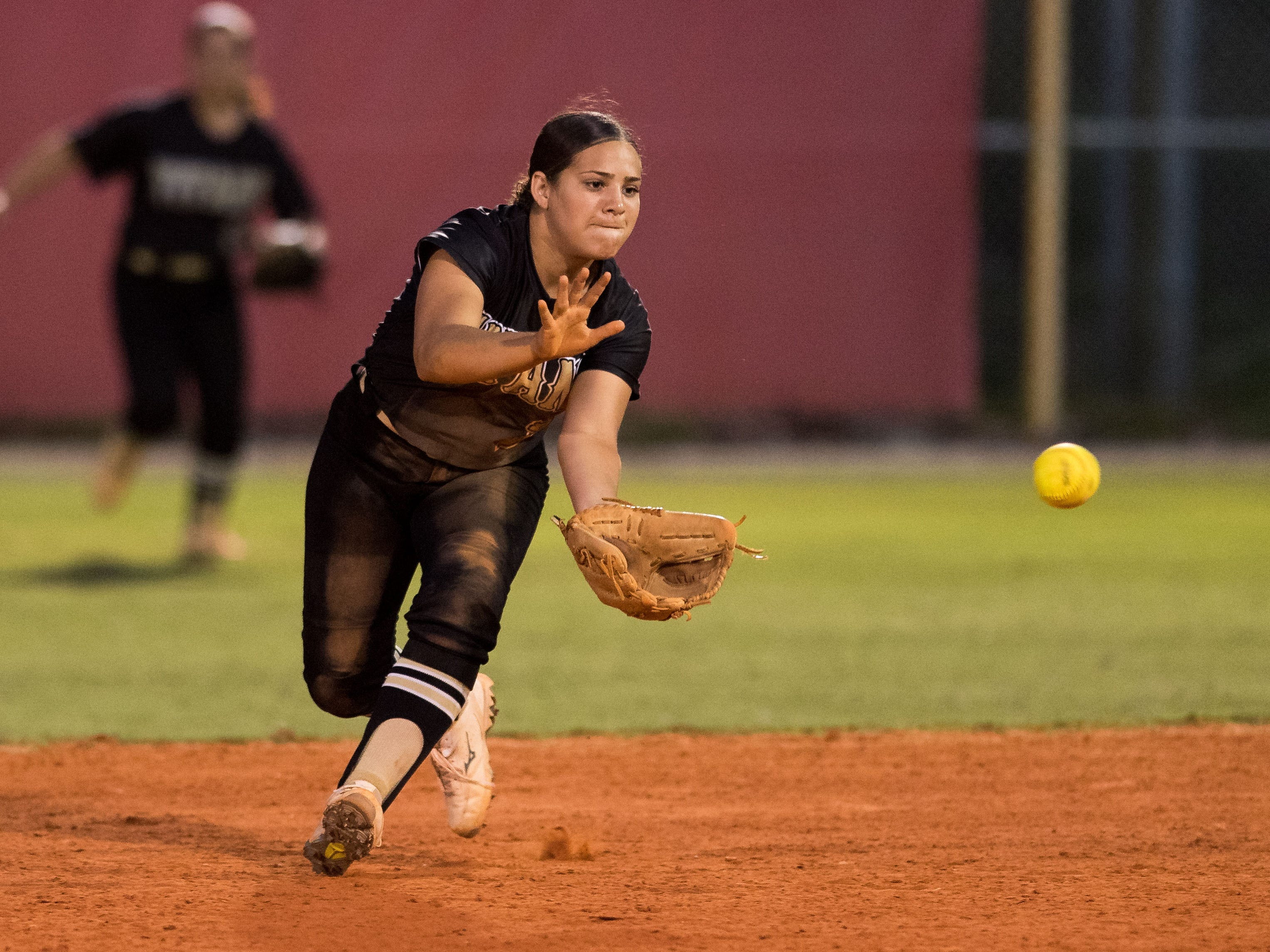 Treasure Coast's Amanda Ruiz fields a grounder by Vero Beach's Summer Washburn for her second fielding out in the fourth inning during the high school softball game Friday, March 29, 2019, at Vero Beach High School.