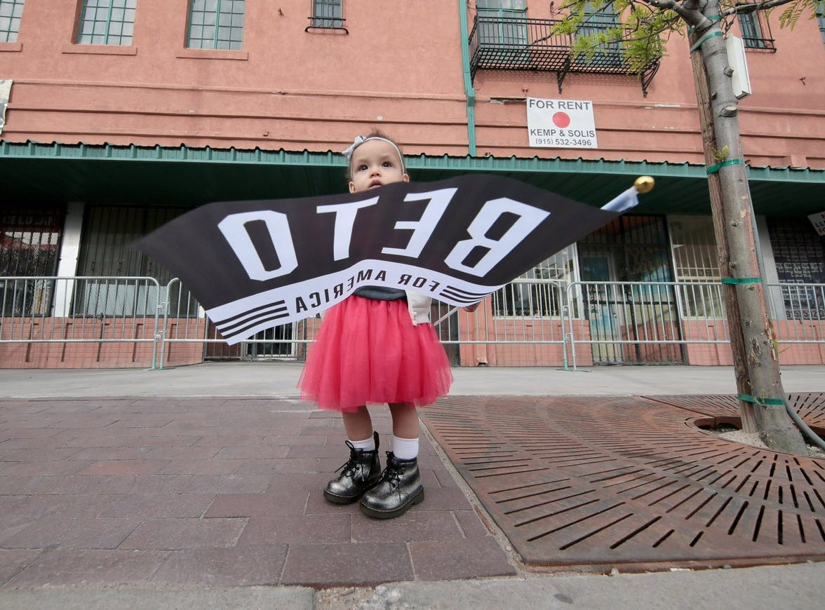 A young girl waved a flag, ready to vote  ... in a few years.