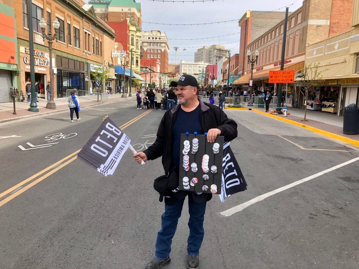Chris Parra sells Beto flags, badges and hats just before the official 2020 campaign kickoff for Beto O'Rourke on South El Paso Street shopping district in Downtown El Paso.