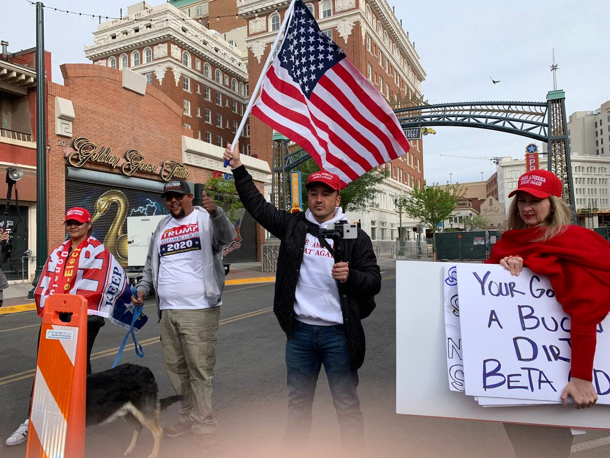 Participants in a counter-rally near Beto O'Rourke's El Paso event waved a U.S. flag before the start of the events.