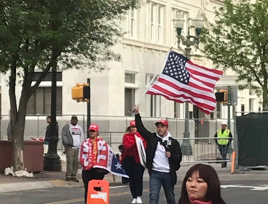 A member of the counter-rally near Beto O'Rourke's El Paso event waved a U.S. flag before the start of the events.