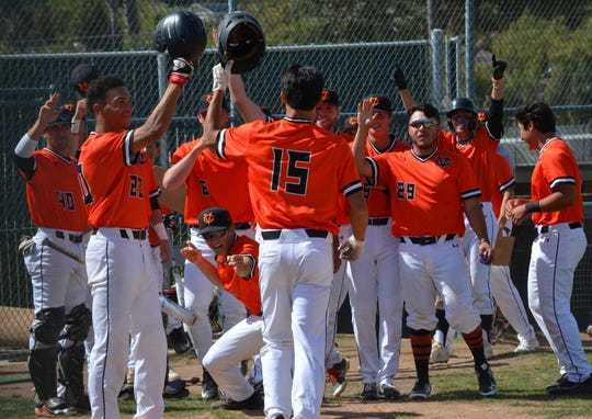 Ventura College baseball players celebrate Ethan Balolong's home run on Tuesday against visiting Hancock College.
