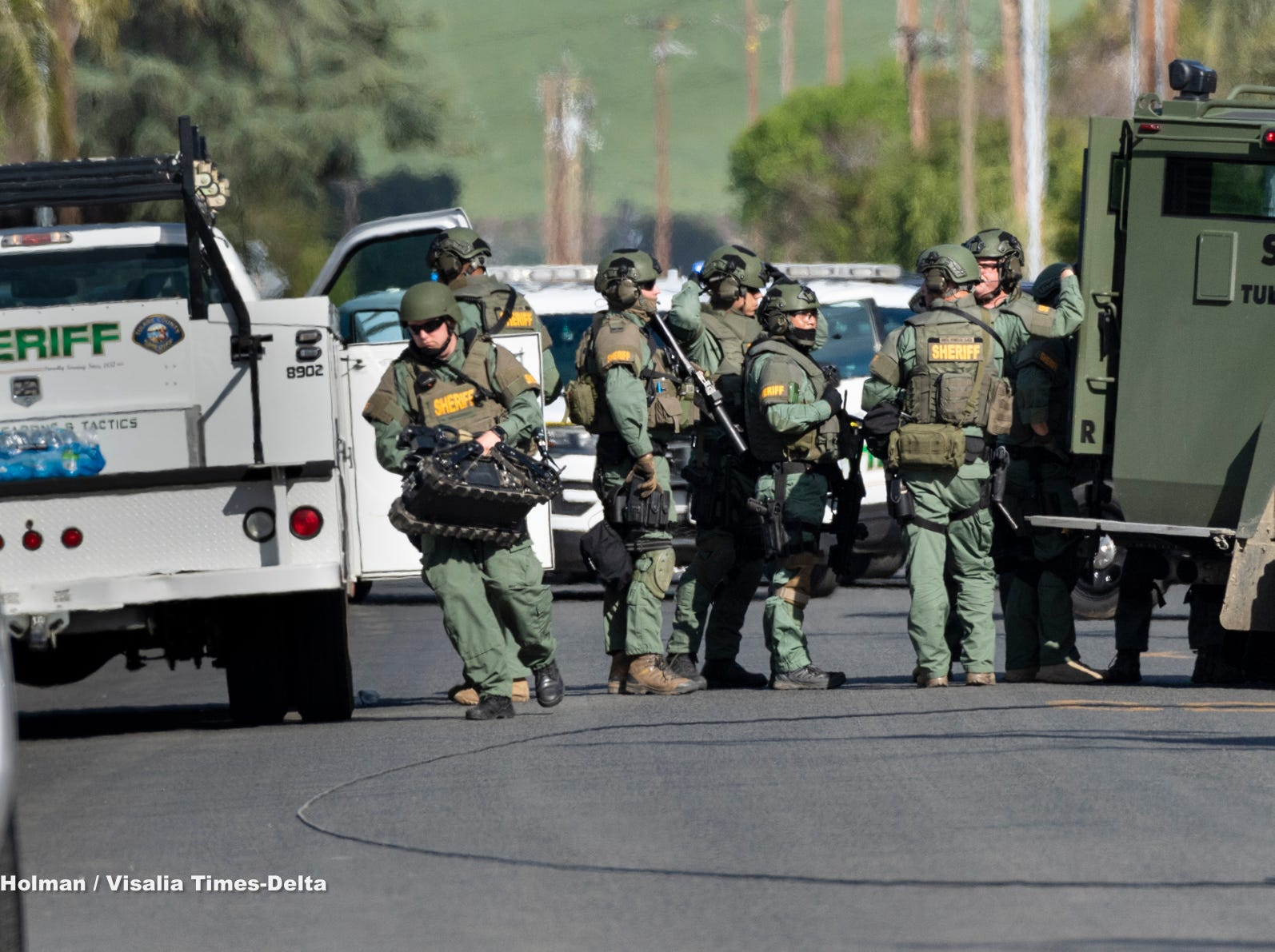 Deputies were called to a home on Road 404 in Cutler near Mueller Street around 1 p.m. on Friday. The deputies were told a man with a knife ran into a neighbor's home and threatened to kill the residents. Eventually Tulare County Sheriff Department's SWAT members deployed a robot, pictured, into the house and determined the man to be unarmed, clearing the way for deputies to enter and take the man into custody about 4 p.m.