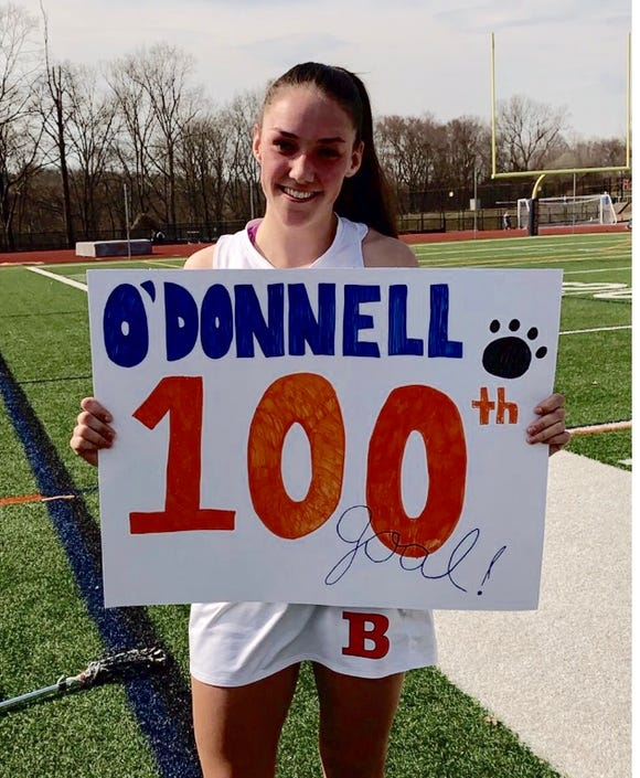 Briarcliff's Kelly O'Donnell celebrates her 100th varsity goal on March 30, 2019.