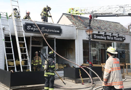 Armonk firefighters, with help from several central Westchester departments, battle a 2-alarm fire at the Bagel Emporium on Main Street in downtown Armonk, March 30, 2019.