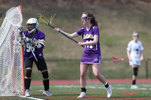 Clarkstown North's Nieve Donegan (11) and goalie Marissa Lavalle (55) work the crease during girls lacrosse action at Albertus Magnus High School in Bardonia on Saturday, March 30, 2019.