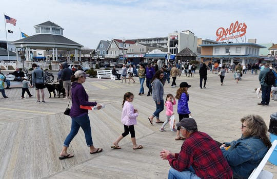 Visitors to the Rehoboth Beach boardwalk.