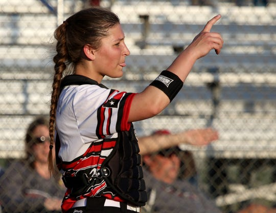 Wichita Falls High School's Emma Kuhrt signals one out in the game against Rider Friday, March 29, 2019, at Sunrise Optimist Field.