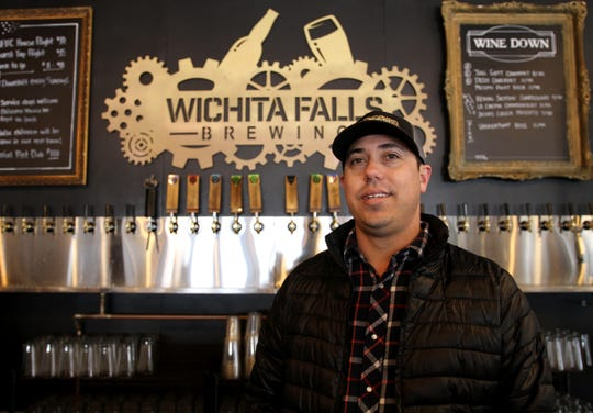Matt Bitsche, owner of Wichita Falls Brewing Company, poses behind the bar Saturday, March 30, 3019, at the one year anniversary party of Wichita Falls Brewing Company.