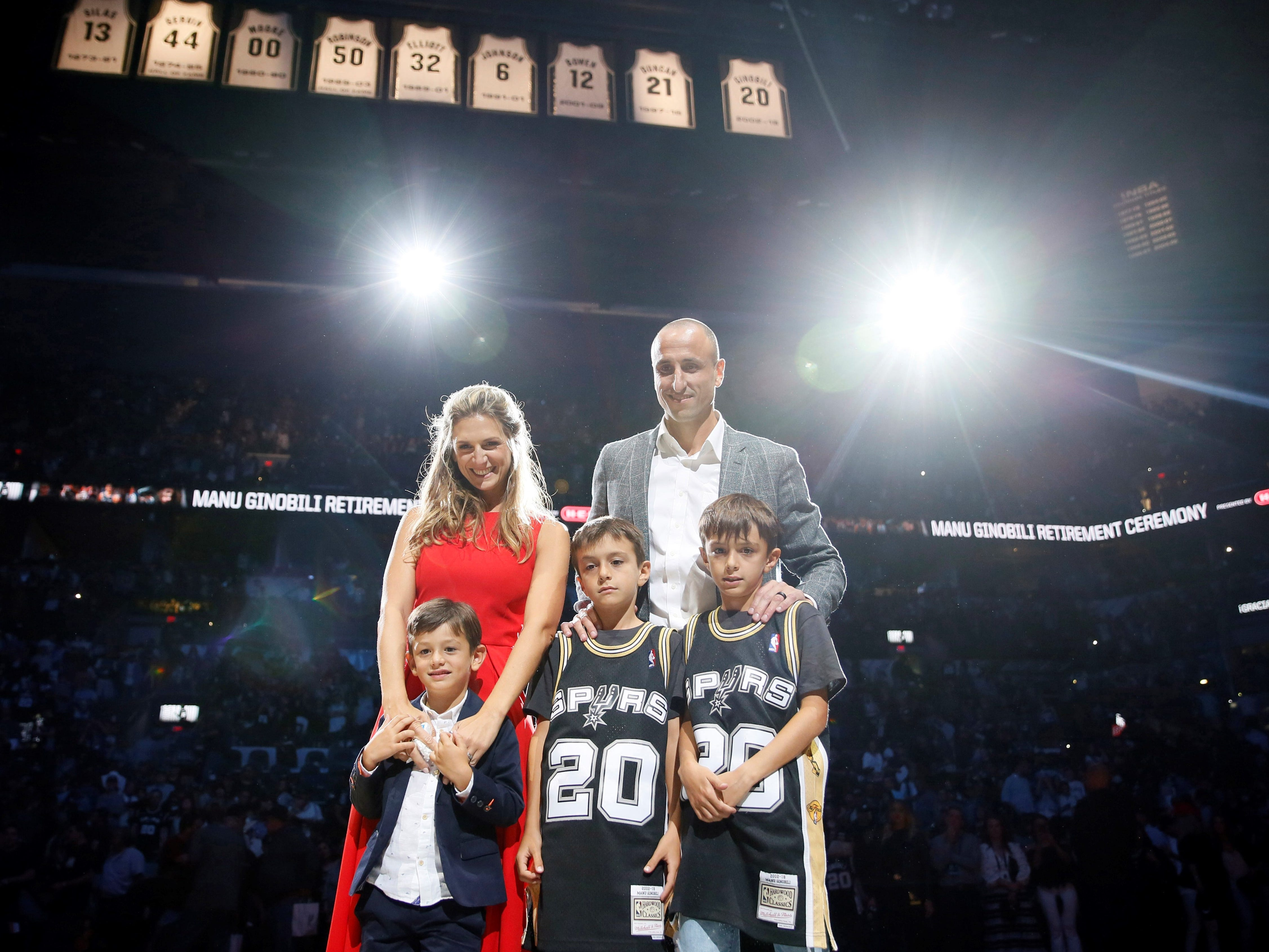 March 28: Spurs legend Manu Ginobili poses with his family after San Antonio retired his jersey in an emotional ceremony.