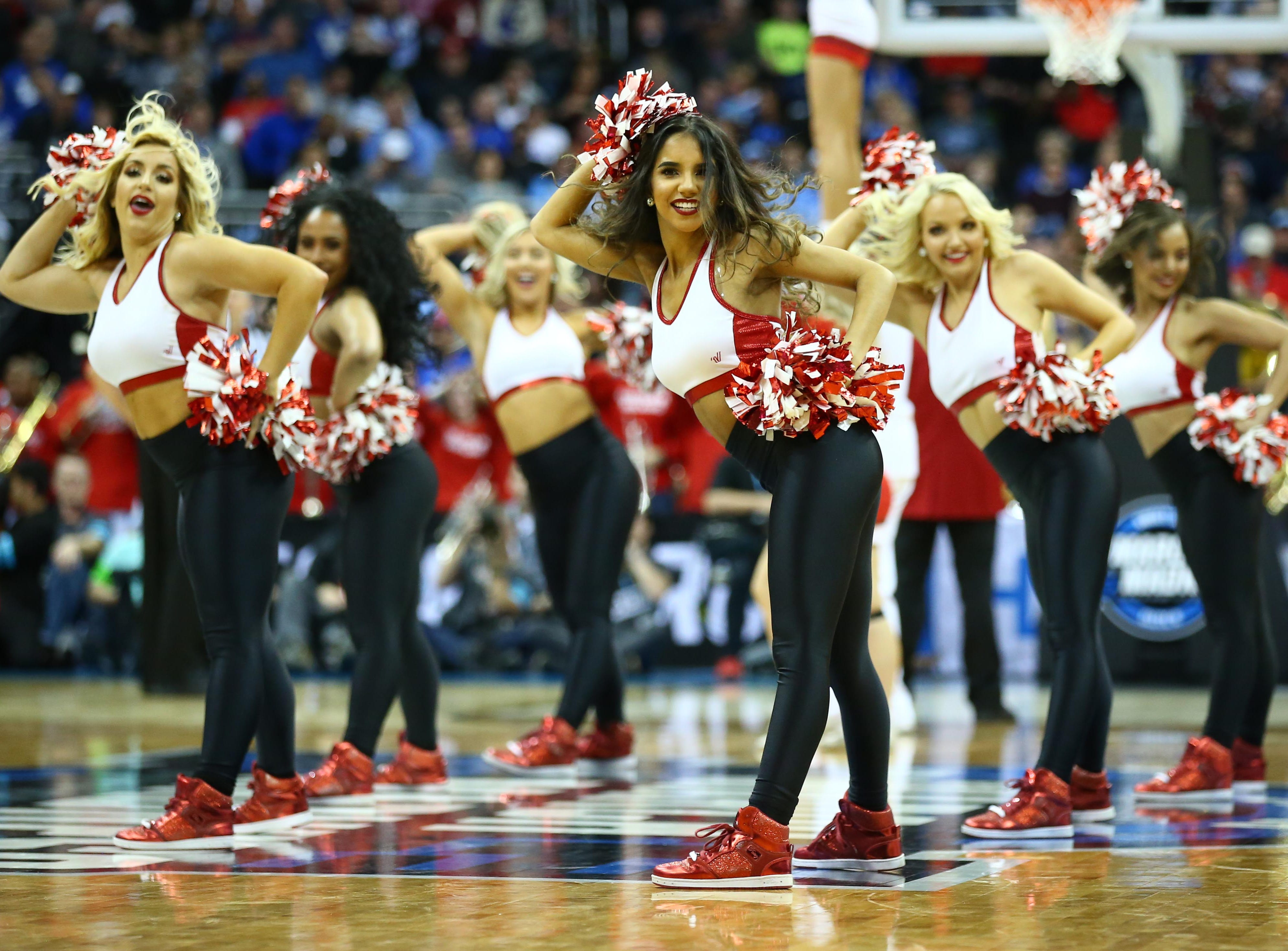 Sweet 16: The Houston Cougars cheerleaders perform during the second half against the Kentucky Wildcats.