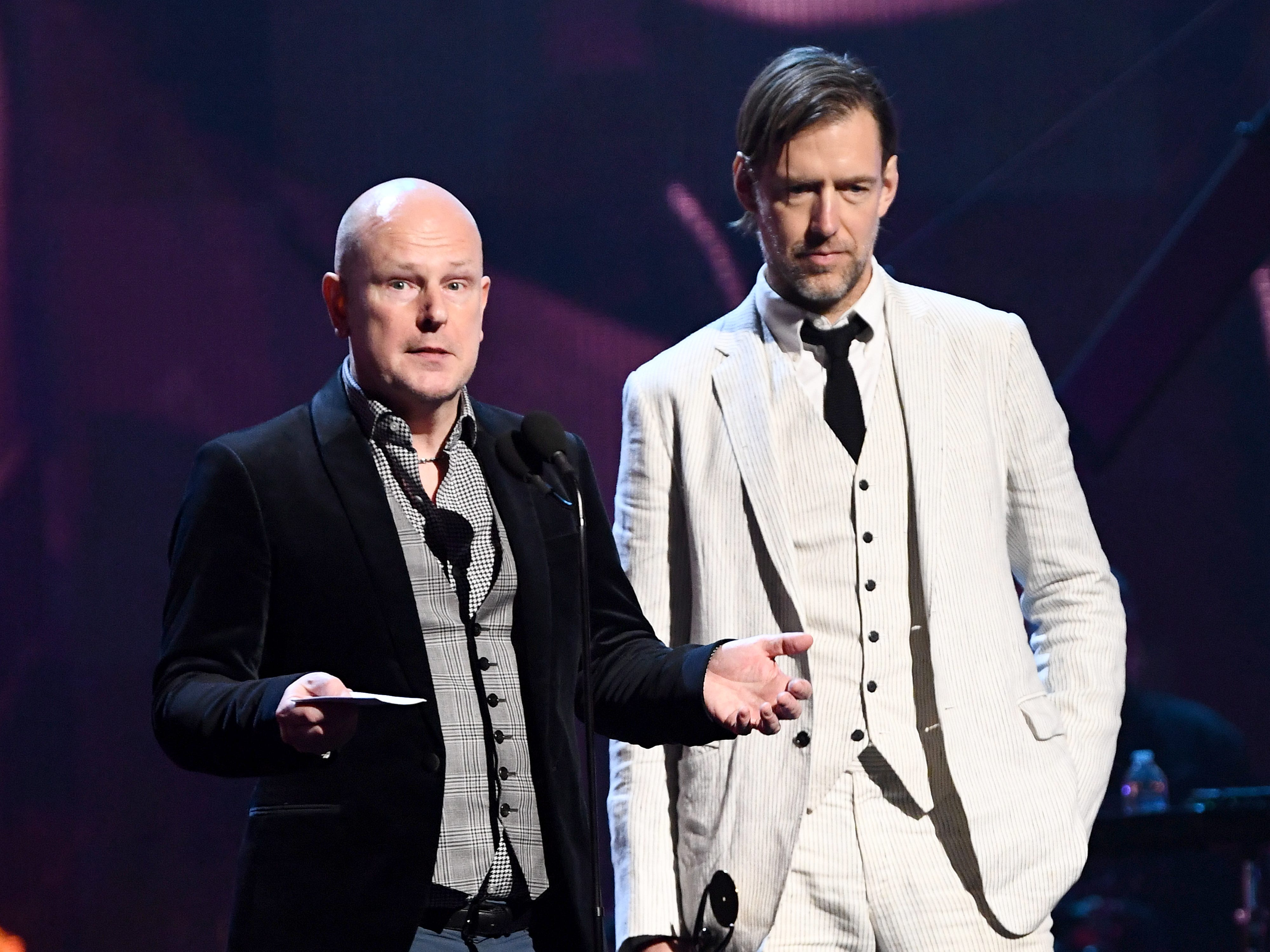 Two-thirds of Radiohead, drummer Philip Selway, left, and guitarist Ed O'Brien, represented the band at its Rock Hall induction.