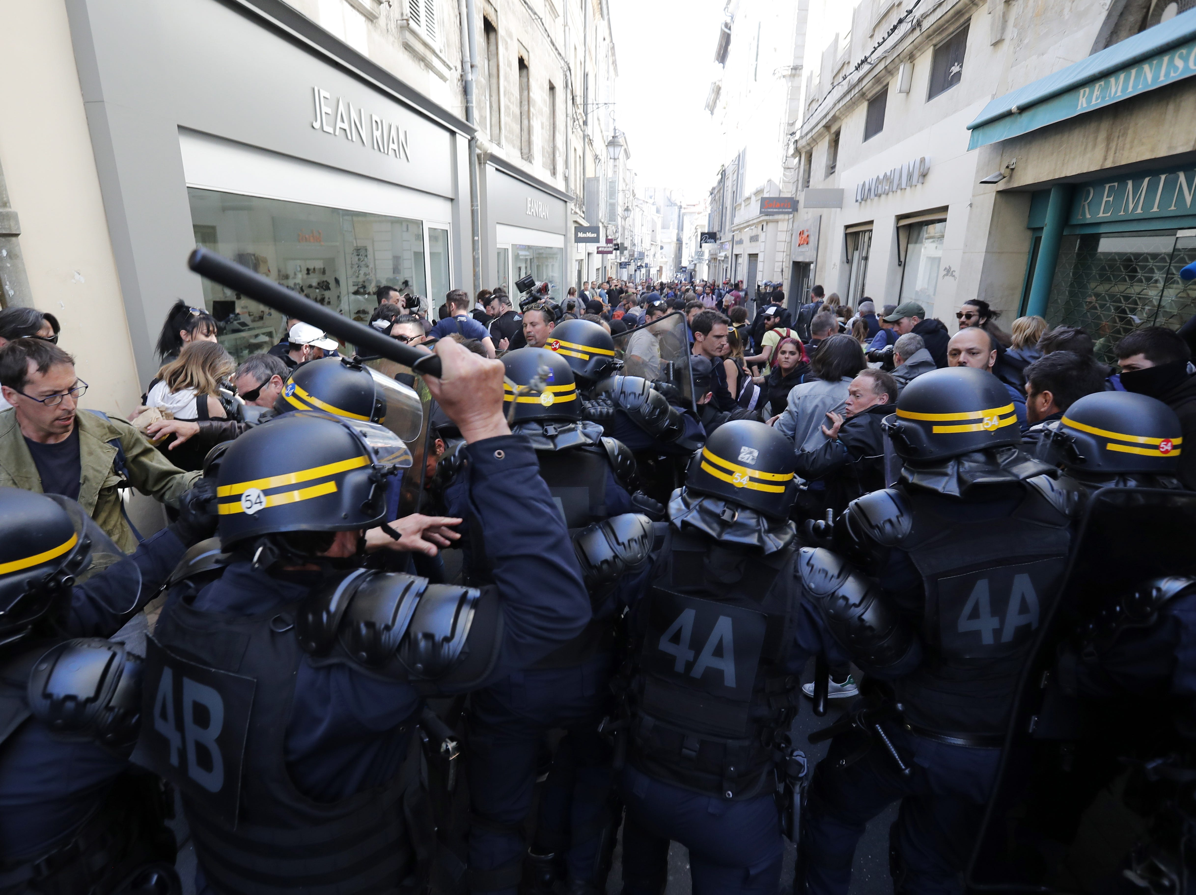 French riot police officers clash with protesters from the 'Gilets Jaunes' (Yellow Vests) movement during the 'Act XX' demonstration (the 20th consecutive national protest on a Saturday) in Avignon, France on March 30, 2019. Yellow Vest protests are expected in several cities across France.