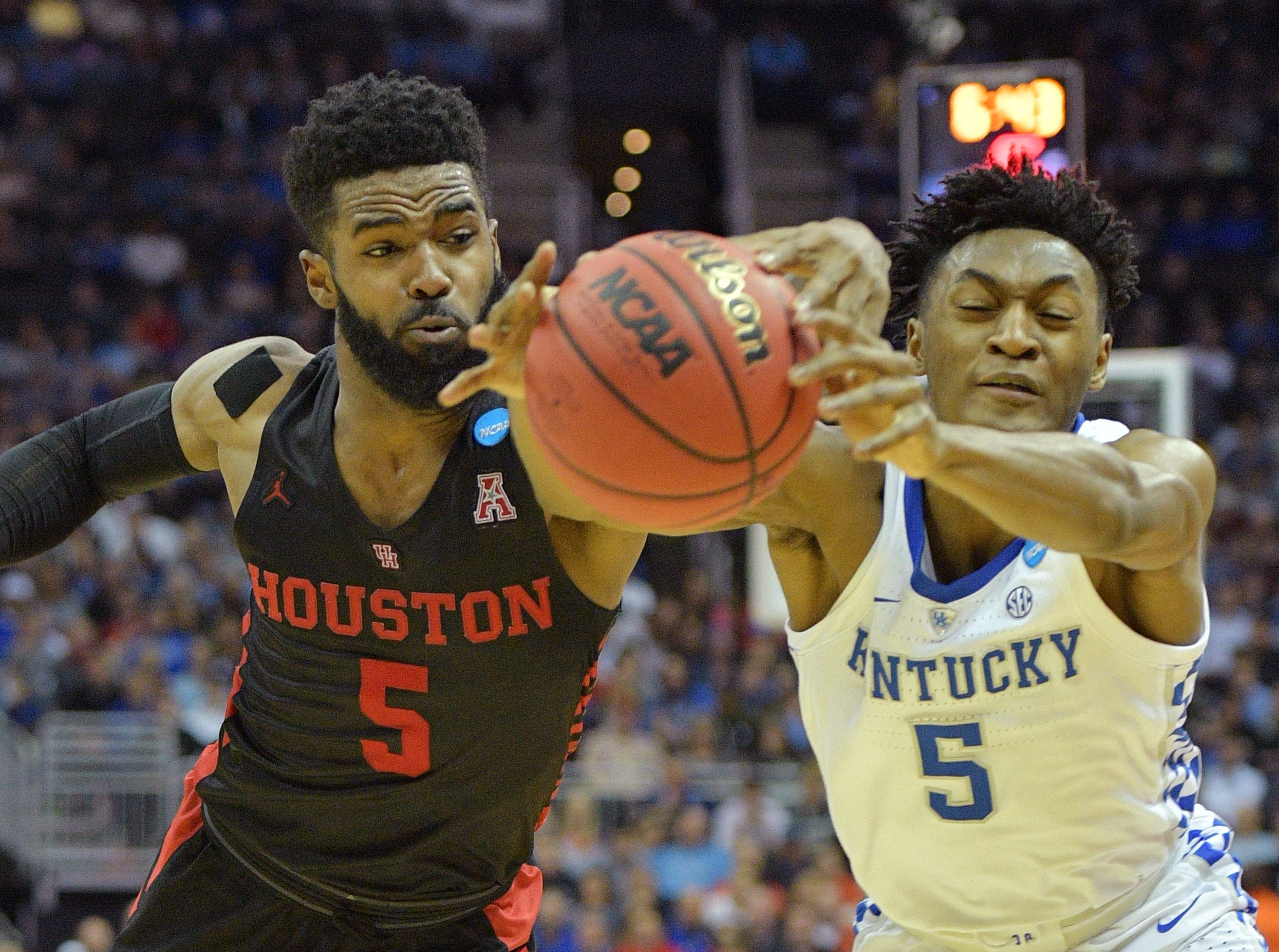Sweet 16: Houston Cougars guard Corey Davis Jr. (left) and Kentucky Wildcats guard Immanuel Quickley reach for a loose ball during the first half.