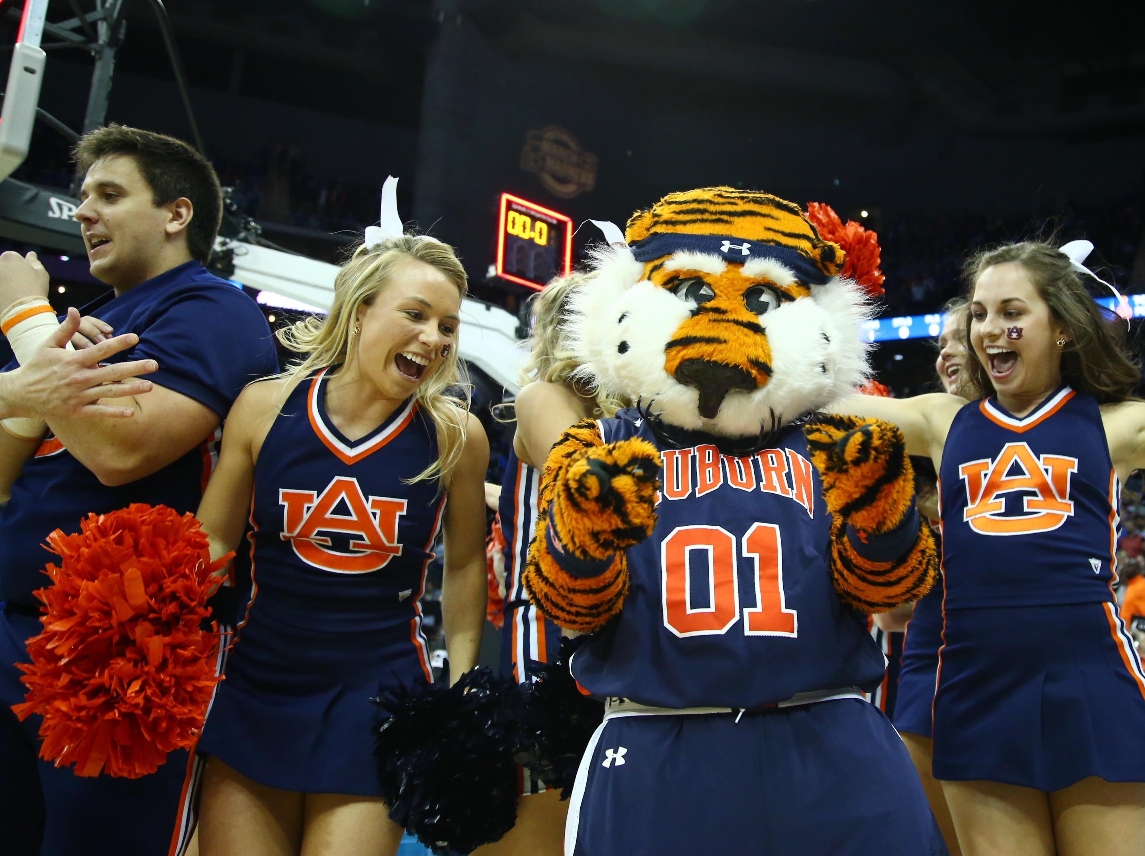 Sweet 16: Auburn Tigers cheerleaders and the mascot celebrate the win over North Carolina.