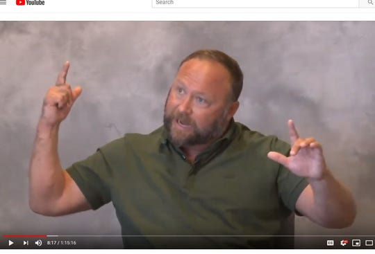 InfoWars host Alex Jones is shown giving a deposition on March 14, 2019 in a video posted on YouTube by the law firm Farrar & Ball, LLP in connection with a lawsuit filed by families of victims of the Sandy Hook shootings.