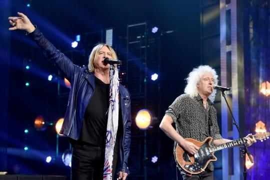 Def Leppard's Joe Elliott, left, performs with Queen's Brian May during Friday's Rock and Roll Hall of Fame induction ceremony in Brooklyn.