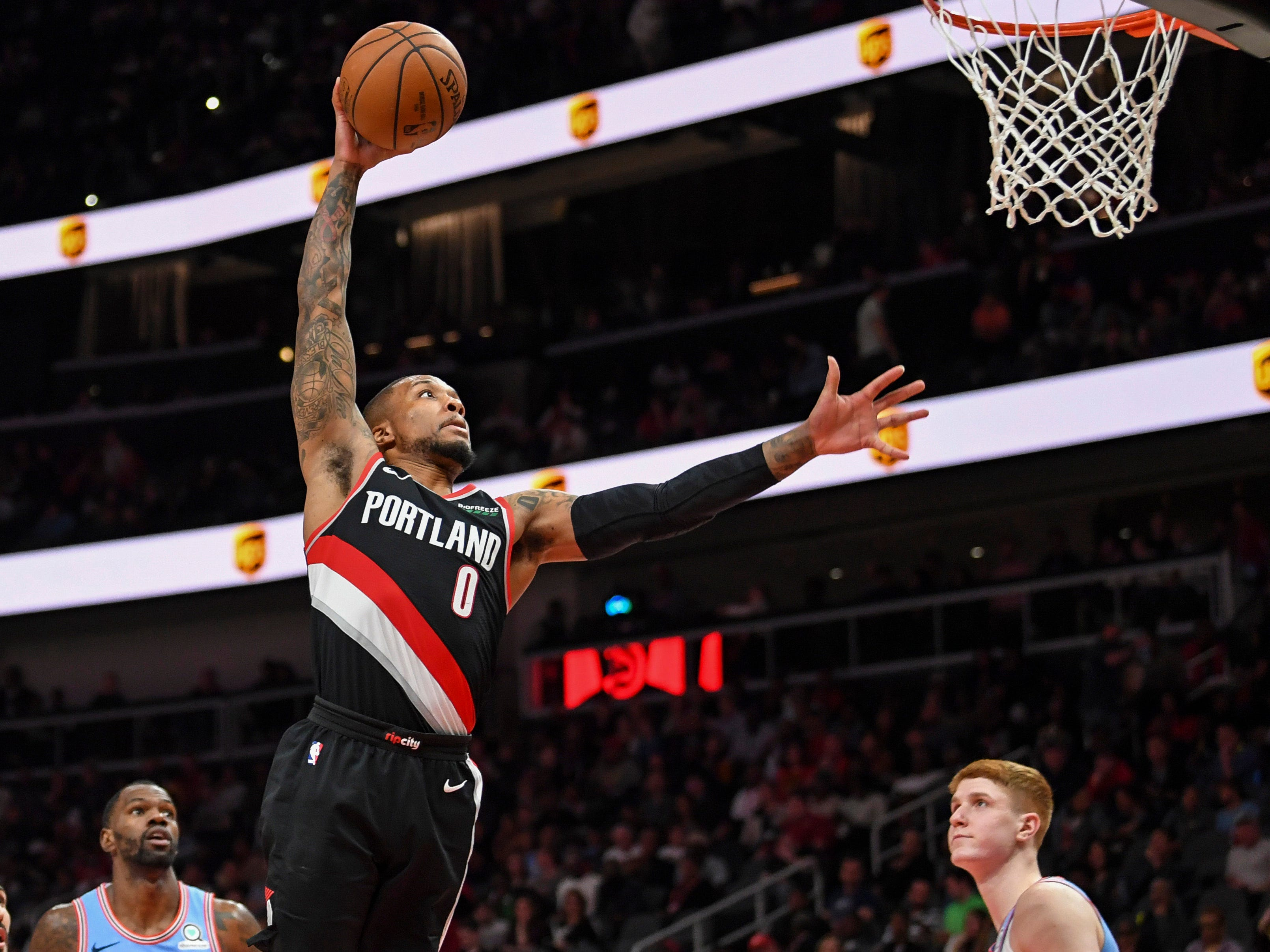 March 29: Trail Blazers guard Damian Lillard rises up for the one-handed slam during the second half against he Hawks.